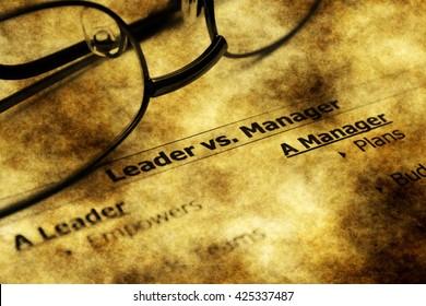 Leader vs. manager grunge concept