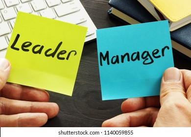 Leader vs manager. Man is holding memo sticks.
