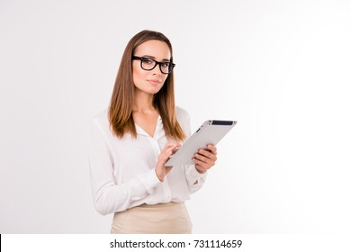 Leadership, authority, femenine dream. Attractive adult boss economist, accountatnt in formal outfit, black trendy eyewear, with her pda, so stylish, successful, intelligent