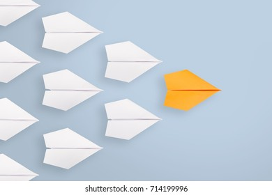Leadership concept with blue paper plane leading among white