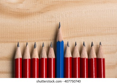 leadership concept blue pencil stand out