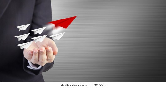 Leadership concept of business woman hand with paper planes