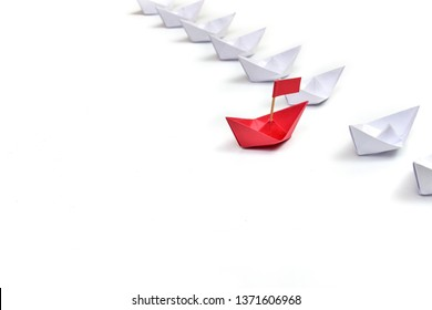 Leadership concept creative design of Red paper ship with group isolated on white background. Boat paper origami view.
