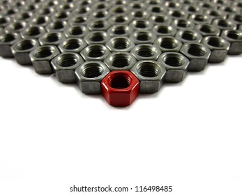 Leadership concept.  Group of nuts with focus on lead nut painted red to designate leadership and leader of the pack.  White space available to add your text.