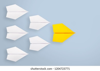 Leadership concept with yellow paper airplane leading among white