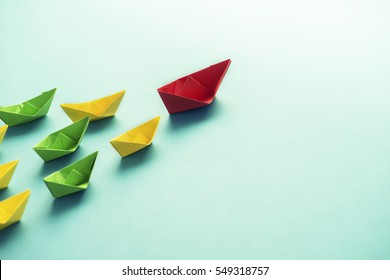 leadership concept-red paper ship leader leading group