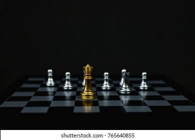 Leadership Concepts, Chess is a leader, Chess game on a black background.