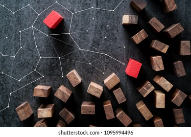 leadership ideas concept with color wood block outstanding from  brown wood block on grey background table