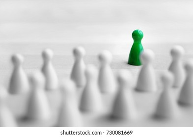 Leadership and management concept. Boss, chief or executive in front of crowd or group. Public speaking and giving presentation. Board game pawns on wooden table.