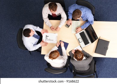 leadership - mentoring, five business people meeting - Businesspeople gathered around a table for a meeting, brainstorming. Aerial shot taken from directly above the table.