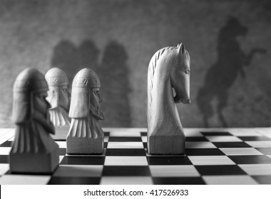 Leadership, success concept, chess piece with a rearing horse as shadow