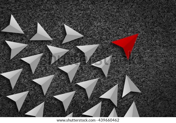 Leadership and Synergy Concept  : A number of white paper arrow against a Bright black texture background lead by a red arrow leader