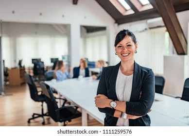 Leadership and teamwork concept. Portrait of confident businesswoman.