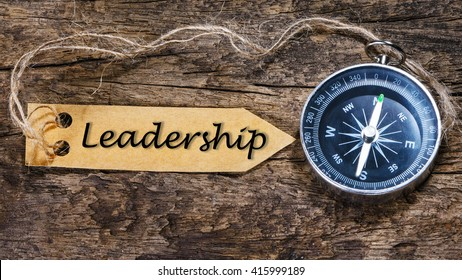Leadership word - business tips handwriting on label with compass