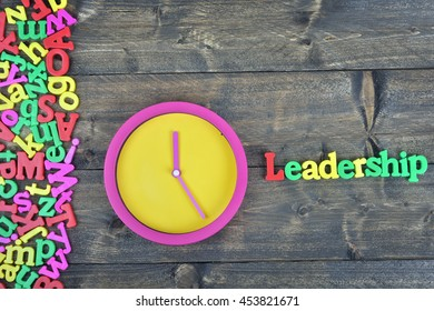 Leadership word on wooden table
