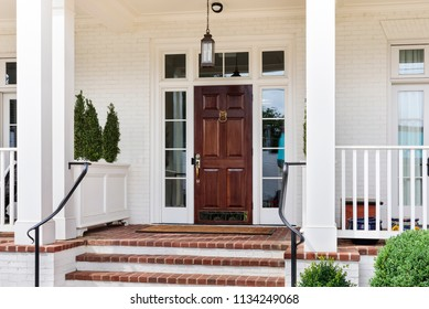 leading up to a brown front door