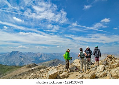 Leadville, CO / USA - August 10, 2018: Hikers at the summit of Mt. Elbert, the highest point in Colorado at over 14,000 feet. Climbing all of the 14ers in Colorado is on many peoples bucket list.