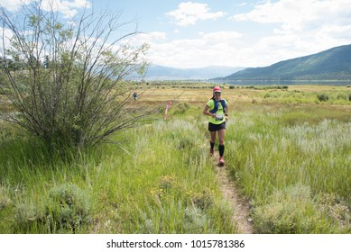 LEADVILLE, COLORADO USA - AUGUST 19, 2017: Raquel Harper outbound from the Twin Lakes aid station during the Leadville Trail 100 Ultra, Leadville, Colorado, USA.