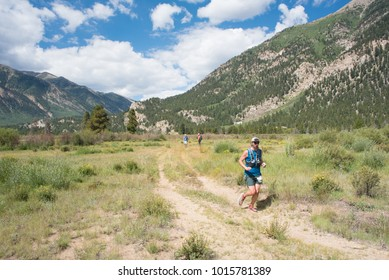 LEADVILLE, COLORADO USA - AUGUST 19, 2017: John Muir outbound from the Twin Lakes aid station during the Leadville Trail 100 Ultra, Leadville, Colorado, USA.