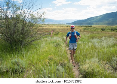 LEADVILLE, COLORADO USA - AUGUST 19, 2017: Bruce Dailey outbound from the Twin Lakes aid station during the Leadville Trail 100 Ultra, Leadville, Colorado, USA.
