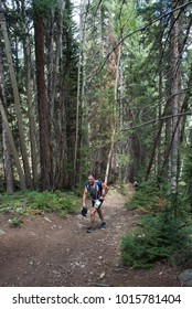 LEADVILLE, COLORADO USA - AUGUST 19, 2017: Luis Guerrero outbound from the Twin Lakes aid station during the Leadville Trail 100 Ultra, Leadville, Colorado, USA.