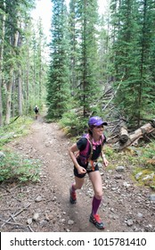 LEADVILLE, COLORADO USA - AUGUST 19, 2017: Caroline Veltri outbound from the Twin Lakes aid station during the Leadville Trail 100 Ultra, Leadville, Colorado, USA.