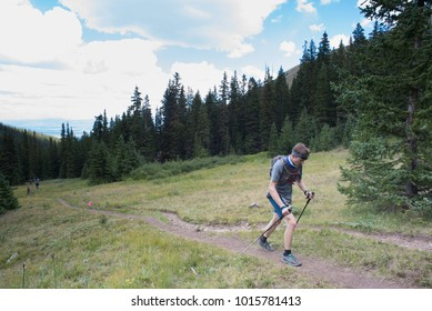 LEADVILLE, COLORADO USA - AUGUST 19, 2017: Stephen Moors outbound approaching the Hope Pass aid station during the Leadville Trail 100 Ultra, Leadville, Colorado, USA.
