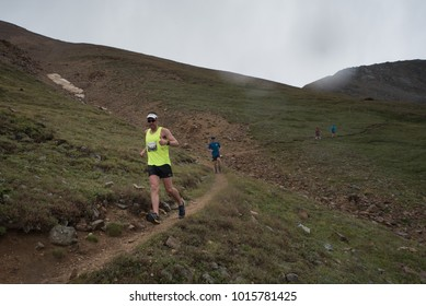 LEADVILLE, COLORADO USA - AUGUST 19, 2017: David Tierney descending inbound from Hope Pass during the Leadville Trail 100 Ultra, Leadville, Colorado, USA.