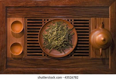 leaf green tea in a clay bowl on the table for the tea ceremony