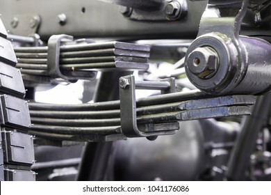 Leaf springs suspension system of a truck  ; chassis part ; industrial background