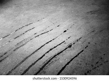 Leaks from asphalt steamroller background