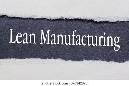 Lean Manufacturing words under torn black paper.