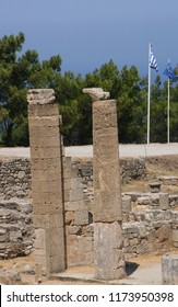 Leaning columns at Greek archaeological site.