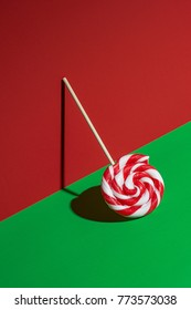 Leaning lollipop on red and green