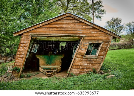 leaning shed stock photo edit now 633993677 shutterstock