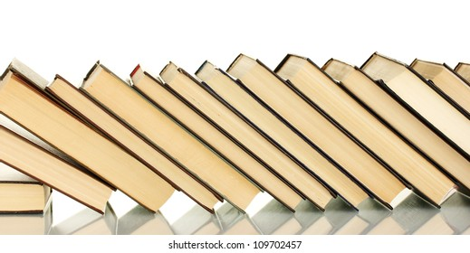 leaning stack of books on white background