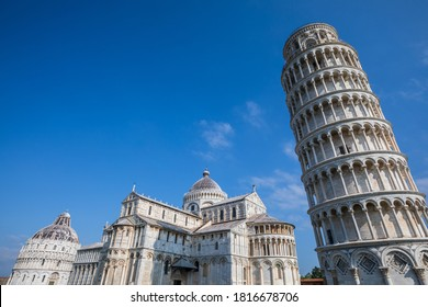 The Leaning Tower of Pisa, campanile, or freestanding bell tower, of the cathedral of the Italian city of Pisa. Blue sky.