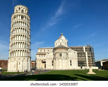 Leaning Tower of Pisa and the Cathedral of Pisa in honor of the Assumption of the Blessed Virgin Mary.
