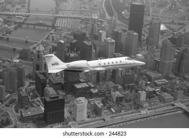 Learjet above Downtown Pittsburgh.