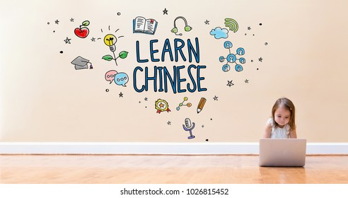 Learn Chinese text with little girl using a laptop computer on floor