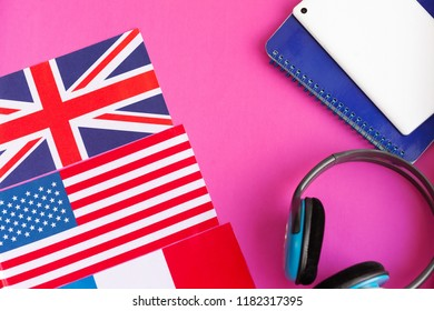 Learn English - British flag, headphones, tablet and notebook on a bright background