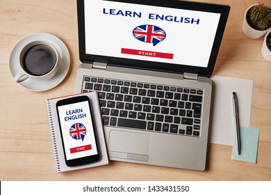 Learn English concept on laptop and smartphone screen over wooden table. Flat lay