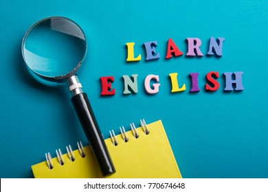 Learn English concept. Time to Learning languages. Word composed from colorful abc alphabet block wooden letters, copy space for ad text.