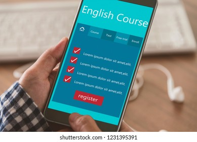 Learn English concept, Use laptops and smartphones to find English learning information on the web.