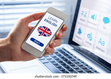 Learn English language online concept with a person showing e-learning app on mobile phone with the british flag of the United Kingdom
