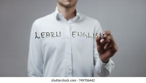 Learn english , Man Writing on Glass