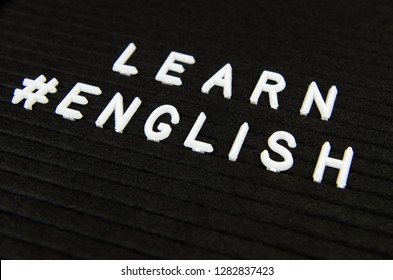 Learn English, modern looking sign on black background for Schools, Teachers, Students