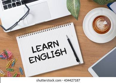 Learn English Tablet with blank black screen and coffee cup
