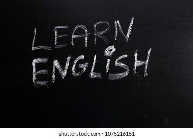 Learn english text written on chalkboard