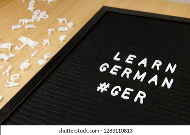 Learn German, GER abbreviation, simple sign on black background, great for teachers, schools, students
